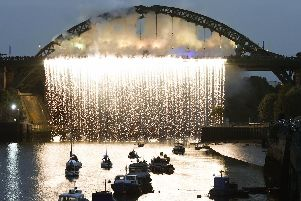 Sunderland's Wearmouth Bridge is lit up during the 2018 Tall Ships' Races.
