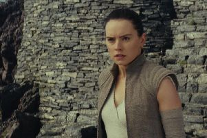 Daisy Ridley as Rey in Star Wars.