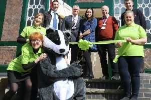 Ellen Fineran, left, Bertie the Badger and project partners celebrate the opening of the Whistlestop Caf� at Matlock Bath station.