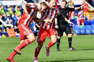 Max Power and Chris Maguire celebrate Sunderland goal at Peterborough United.