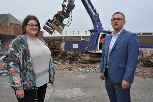 Coun Alex Samuels, left, and candidate Michael Butler, watch on as contractors clear the former Bingo Hall site, Southwick, Sunderland.