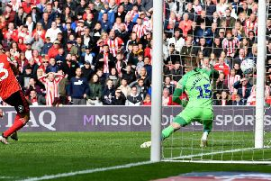 Craig MacGillivray makes a late save from Will Grigg