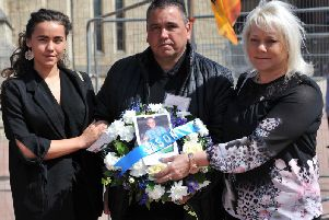 The family of Jason Burden, dad Trevor, mum Maria and sister Rachel, lay a wreath at Hartlepool's Workers Memorial Day Service.