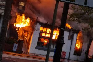 The building next door to the garage was also well alight. Pic: Jason Vasey.