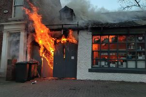 Fire tears through the garage building. Picture by Ian David Kirby.