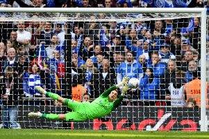 Craig MacGillivray saves Lee Cattermole's penalty in the Checkatrade Trophy final shoot out
