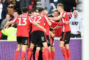 The Sunderland players celebrate Chris Maguire's goal in the 1-0 first-leg win over Portsmouth at the Stadium of Light.