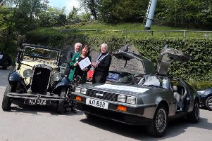 Simone Enefer-Doy cheif excecutive of the charity Lifelites hands over a certificate to Chris Palmham master elect classic cars lodge looking on is Philip Marshall provincial grand master of Nottinghamshire.