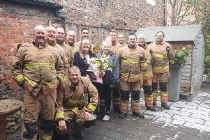 Firefighters present Sharon Gallagher and daughter Beth with flowers