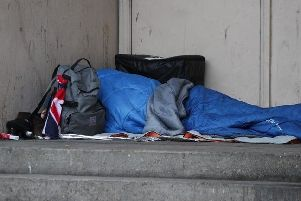 Someone living rough on the street.