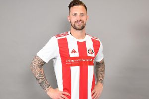 Chris Maguire celebrates the new Sunderland AFC strip.
