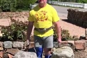 Mark lifts the stones