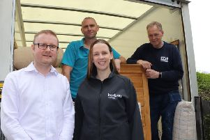 Oasis Community housing Relationship Manager, David Foster, receiving the furniture delivery from Paul Walton and Alan Hayes from the Enterprise Durham Partnership and Sarah Lock, Sales and Marketing Manager from Karbon Homes.