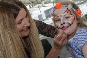 Rooaar! Kids can have their faces painted at the National Glass Centre's birthday party.