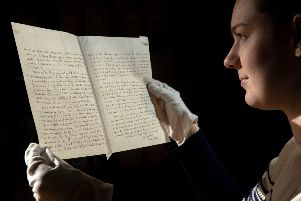 Charlotte Craig, curatorial assistant at Bronte Parsonage Museum, with  the letter to Charlotte Bront� from the poet laureate, telling her that writing was no job for a woman.' 'Picture by Bruce Rollinson