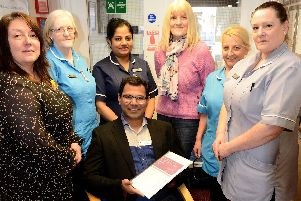 Bijumon Joseph owner and manager of Marigold Nursing Home with their Outstanding Certificate and staff members (left to right0 Joanne Fielden, Lynn Davison, Noby Biju, Yvonne Ivey, Doreen Hardy and Diane Mason.