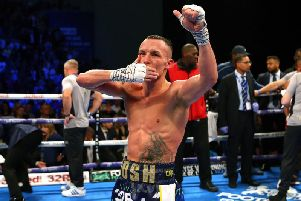 Josh Warrington salutes the crowd after his IBF title win over Kid Galahad.