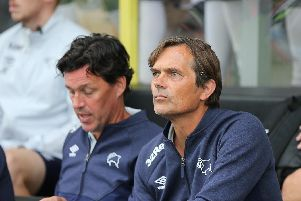 Derby's new manager watches on.