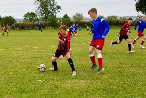 Phoenix Colts Under-15s, red and black stripes, in action during the win against Copmanthorpe