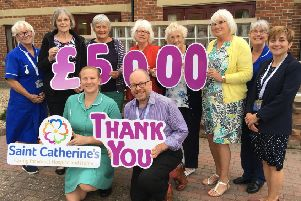 Members of Hunmanby Cancer Fund present the cheque to the hospice.