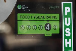 A Food Standards Agency rating sticker on a window of a restaurant.