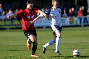 Josh Barrett (white shirt) in action for Tadcaster Albion, has joined Boro