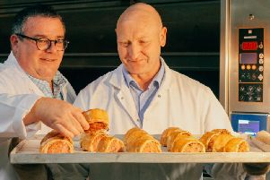 Simon Thomas and Steve Cockayne from Thomas the Baker inspect the award-winning Deli black pudding sausage rolls.