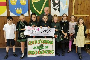 Kevin O'Connor's Irish School of Dance members are pictured with the �500 cheque from Proudfoot supermarkets.