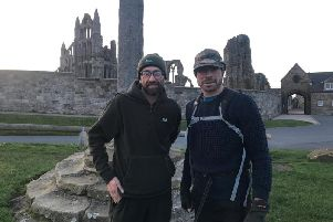 (Left to right): Simon Whitehead and Ben Potter at Whitby Abbey after finishing their gruelling 109 miles walk along the Cleveland Way to raise awareness for mental health.