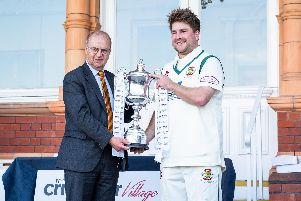 Flixton skipper Will Norman receives the trophy. Picture by Will Palmer.