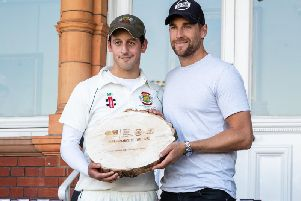 Middlesex and Englands Dawid Malan hands over an award to Matt Nesfield. Picture by Will Palmer.