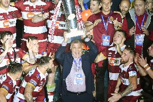 Wigan coach Shaun Wane celebrates the Grand FInal win with his players (SWPix)