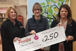 Tim Harvey (centre) receives the cheque from Proudfoot and Nisa.