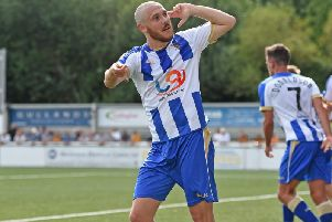 Liam Noble celebrates opening his account for Pools at Maidstone on the first day of the season.