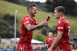 Bailey Gooda celebrates a goal with Wayne Brooksby