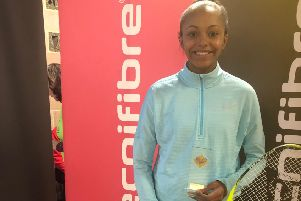 Asia Harris with her trophy after winning the Surrey Open gold event.