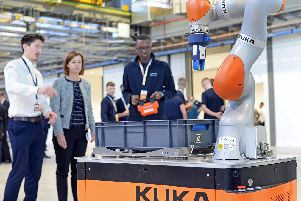Harry Agina, Machinist Apprentice, pictured trying out a Autonomous Guided Vehicle (AGB), a collaborative Robot. Picture: Marie Caley NSTB-25-10-18-Boeing-2