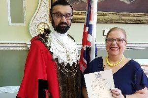 Frederika Roberts is awarded her British citizenship by civic Mayor Coun Majid Khan.