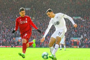Dwight McNeil in action against Liverpool