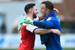 Alex Cairns celebrates Fleetwood's latest clean sheet with Lewie Coyle