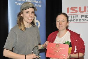Lydia Slack, left, collecting her best actress award at the NFYFC performing arts final.