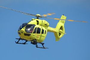 Images on Twitter show the Air Ambulance landing in the theme park near one of the rides