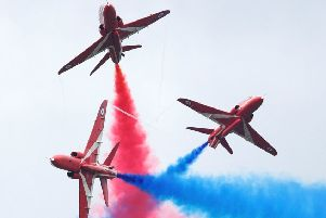 A typically spectacular routine by the Red Arrows aerobatics display team. (PHOTO BY: Dan Kitwood/Getty Images)