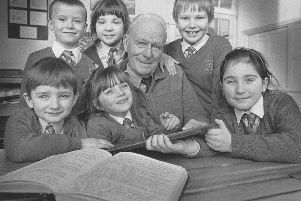 The Gladstone Road Junior School centenary took place in January 1990. Pupils are pictured with former pupil Alf Pottage.