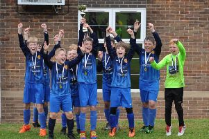 Hunmanby Hornets under-10s celebrate  their triumph at the first-ever Scarborough Football Festival