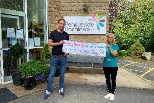 James Robbins presenting his cheque to Jo Applegate, of Pendleside Hospice.