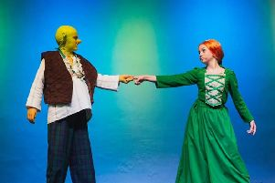 Levi Martin and Bella Withnell in Shrek the Musical Jr, presented by Pendle Hippodrome Youth Theatre. Photo credit: Sarah Redman Photography.