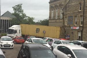 A lorry has become stuck at the end of Dole Lane in Chorley town centre this morning (July 1)