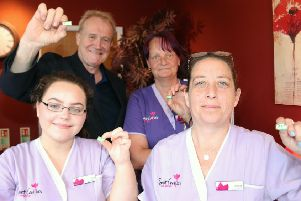 Staff at Scarborough care provider Saint Cecilia's with their CARE badges.