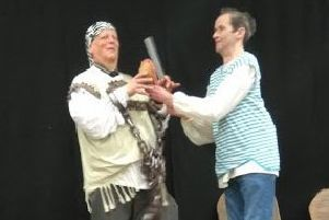Philip Hyde and Paul Johnson perform as Pip and Magwich.